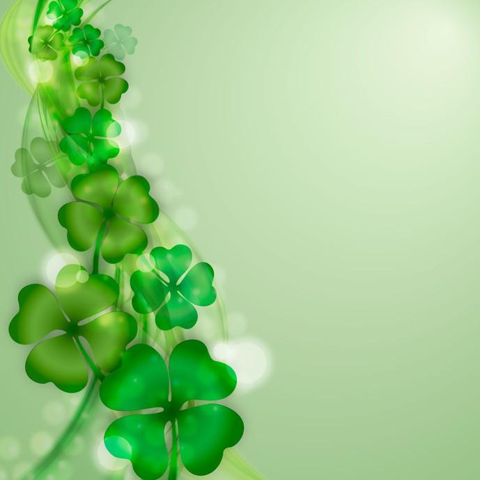 وکتور برگ های با طراوت شبدر در زمینه سبز